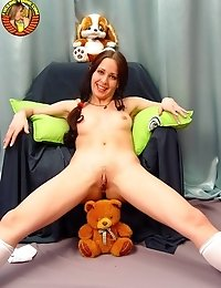 Pigtailed teen with a toy
