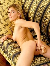 This hot young blonde is tired of waiting for a man so she takes a fat dildo deep inside her pussy