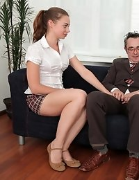 Inga is with her sexy classmate, and together they bring their older teacher to the couch. They place their young and sexy hands on his older cock and