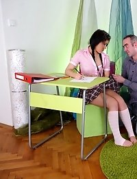Vika is in the school room wearing a hot and sexy outfit. She has misbehaved and her teacher wants her to wait to serve her punishment there with him.