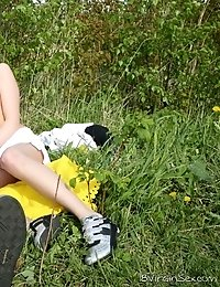 Tracy and her stud decided to spend the sunny summer day outside under the clear blue sky. They undressed and fucked in the field and it was great.