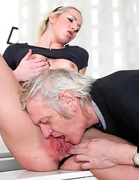 Nelya is a sexy blonde with a great body, and has her top lifted to have her sexy tits licked and sucked by her older lover.