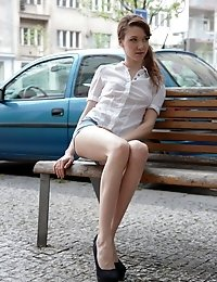 Kristina is a sexy 18 year old beauty, and she is patiently waiting on a city park bench waiting for her sexy man to arrive.