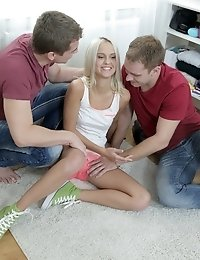 The feeling of one guy's dick on her hand and the expertise of the other guy licking her spoiled virgins pussy drove Veronika wild with pleasure.