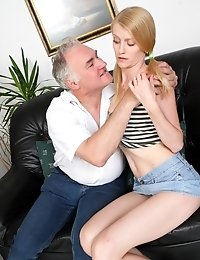 Ginger puts her fingers on her chin, looking at her sexy older lover stroke his older cock. He strokes it to get hard for his younger lover and she en